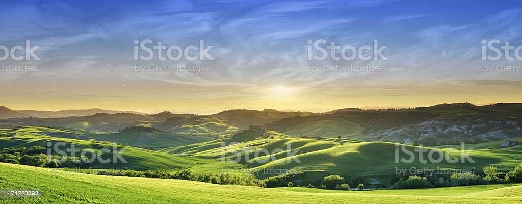 Idyllic landscape - Sunset over green fields of Tuscany stock photo