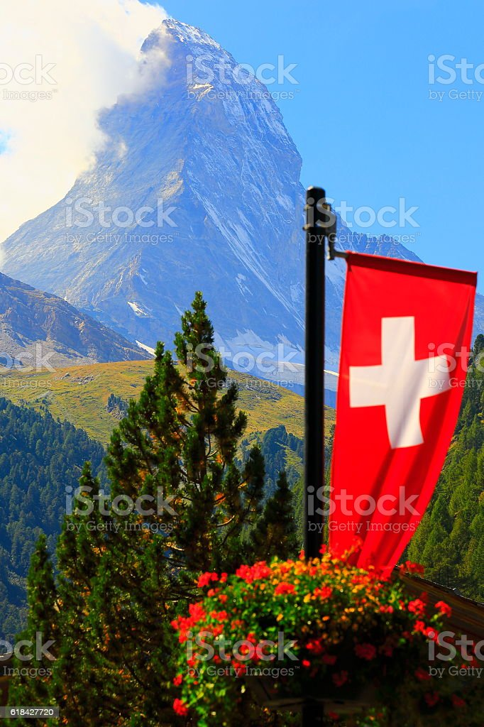 Idyllic Matterhorn and Swiss Flag -  alpine landscape, Zermatt, Swiss Alps stock photo