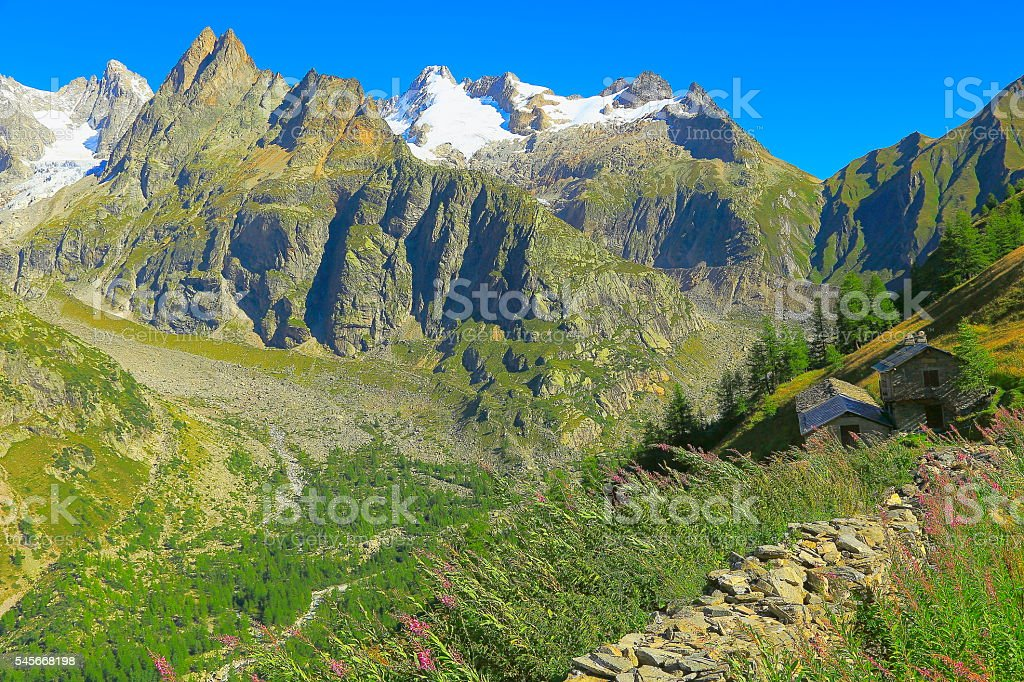 Idyllic Mont Blanc alpine countryside landscape, stacked Stones rifugio, Aosta stock photo