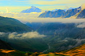 Idyllic Mont Blanc Alpine landscape sunrise above clouds and valley