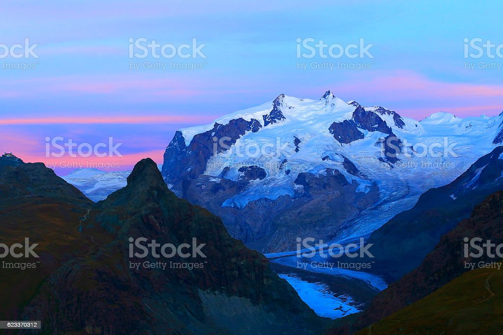 Idyllic Monte Rosa above Gorner glacier dramatic evening, Swiss Alps stock photo