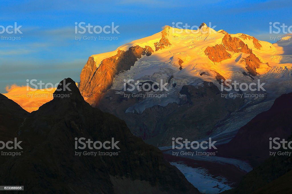 Idyllic Monte Rosa above Gorner glacier golden sunset, Swiss Alps stock photo