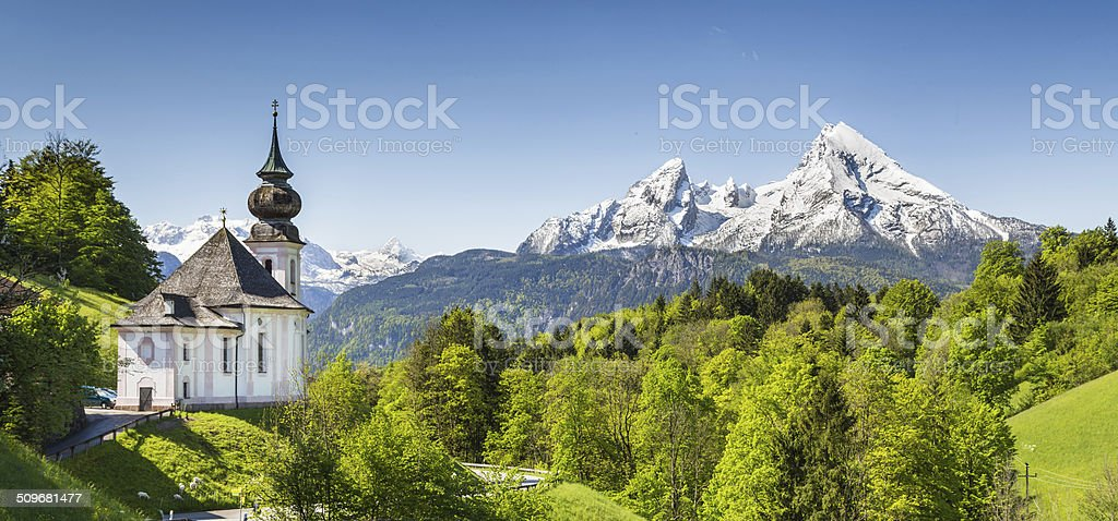 Idyllic mountain landscape with pilgrimage church in the Bavarian Alps stock photo