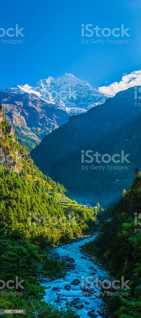 Idyllic mountain valley snowy peaks overlooking Sherpa village Himalayas Nepal stock photo