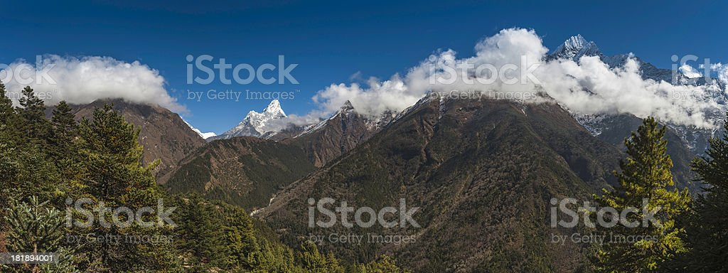 Idyllic mountain wilderness green forest snowy peaks panorama Himalayas Nepal stock photo