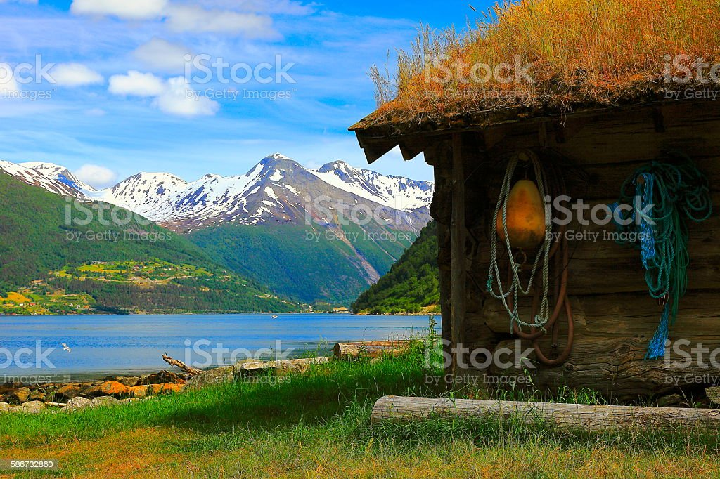 Idyllic Norwegian Fishermen Rorbu farm on fjord, Countryside landscape, Norway stock photo