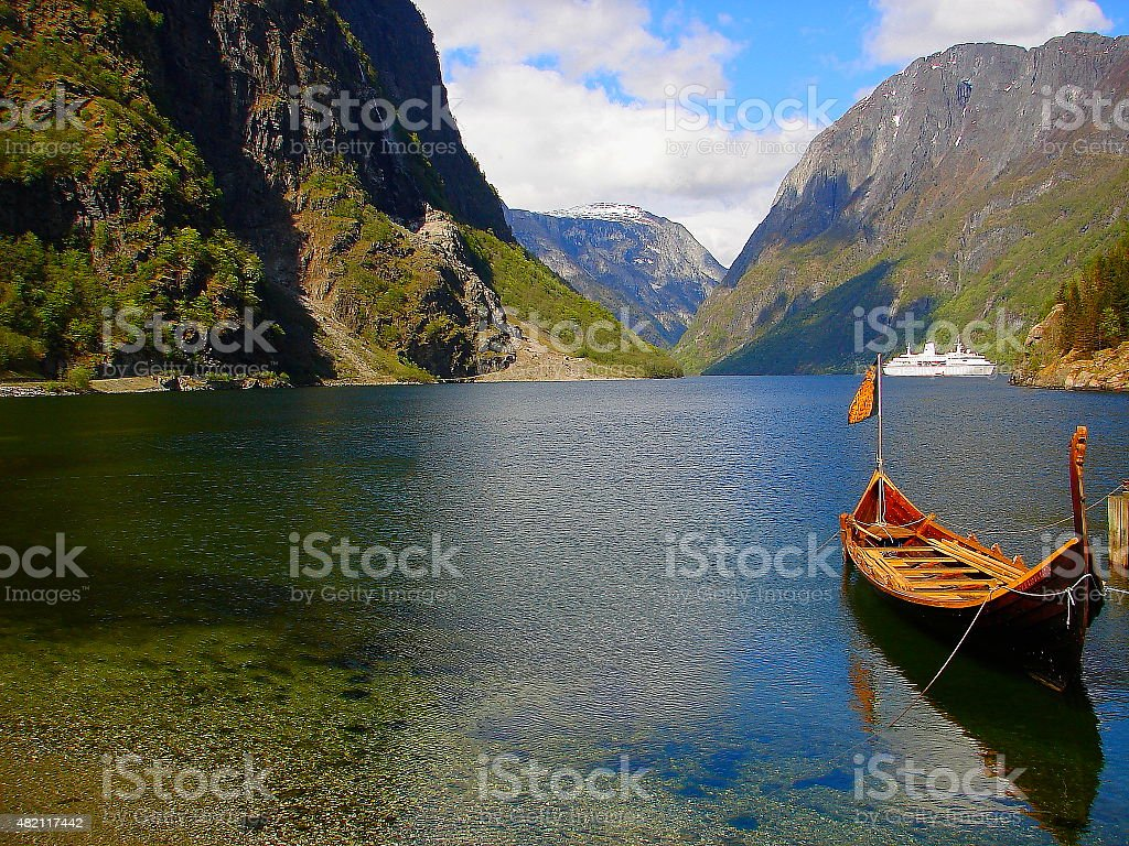 Idyllic Nærøyfjord: fjord landscape, viking boat, Norway, Nordic countries stock photo