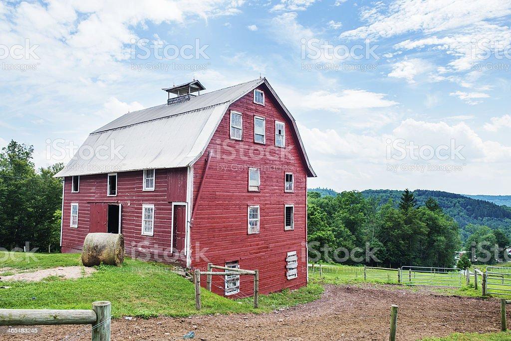 Idyllic Red Barn on Green Grass stock photo
