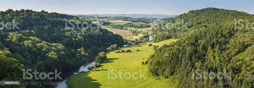 Idyllic river valley green patchwork landscape farms forests stock photo
