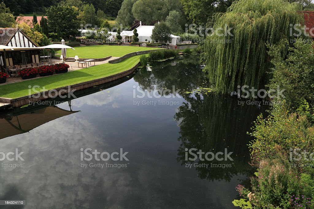 idyllic riverside venue restaurant with marquee river and willows royalty-free stock photo