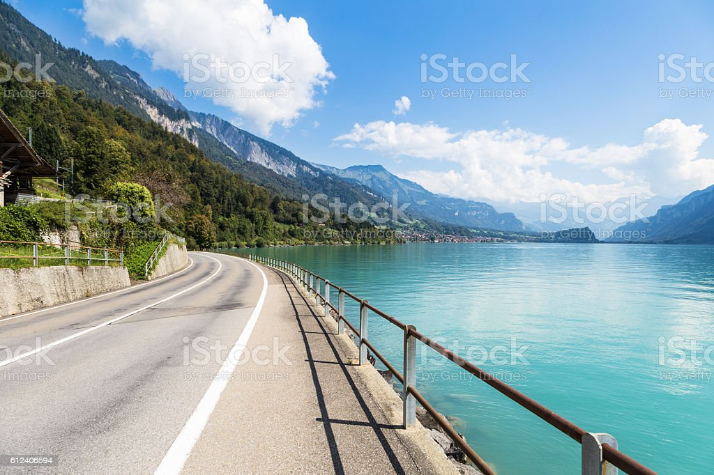 Idyllic road along the Lake Brienz in Switzerland stock photo