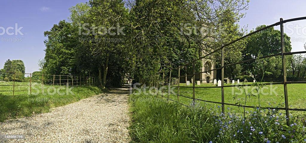 Idyllic rural drive to churchyard royalty-free stock photo