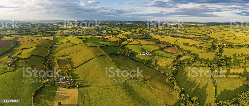 Idyllic rural landscape fields farms aerial panorama royalty-free stock photo