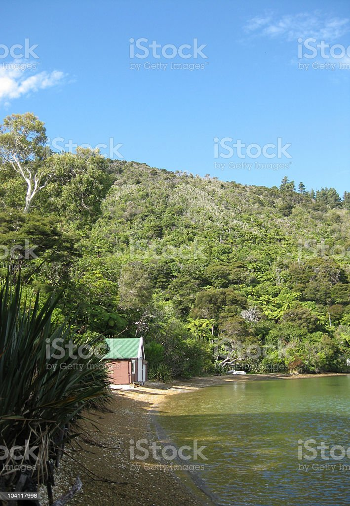 Idyllic scene of boat house on a secluded beach royalty-free stock photo