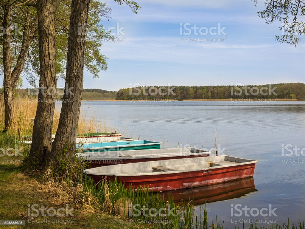 Idyllic scenery of a lake with boats in summer stock photo