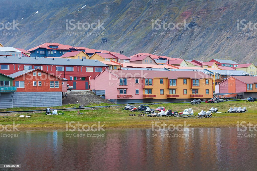 Idyllic scenic view, colorful houses and green field with arctic stock photo