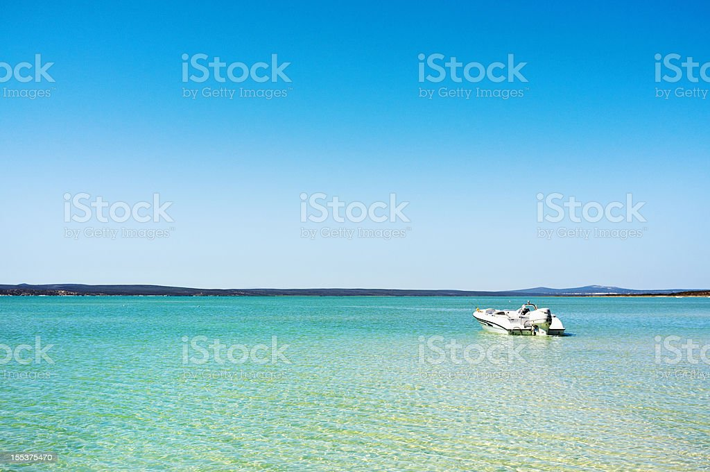 Idyllic seaside scene with sea sky and moored boat royalty-free stock photo