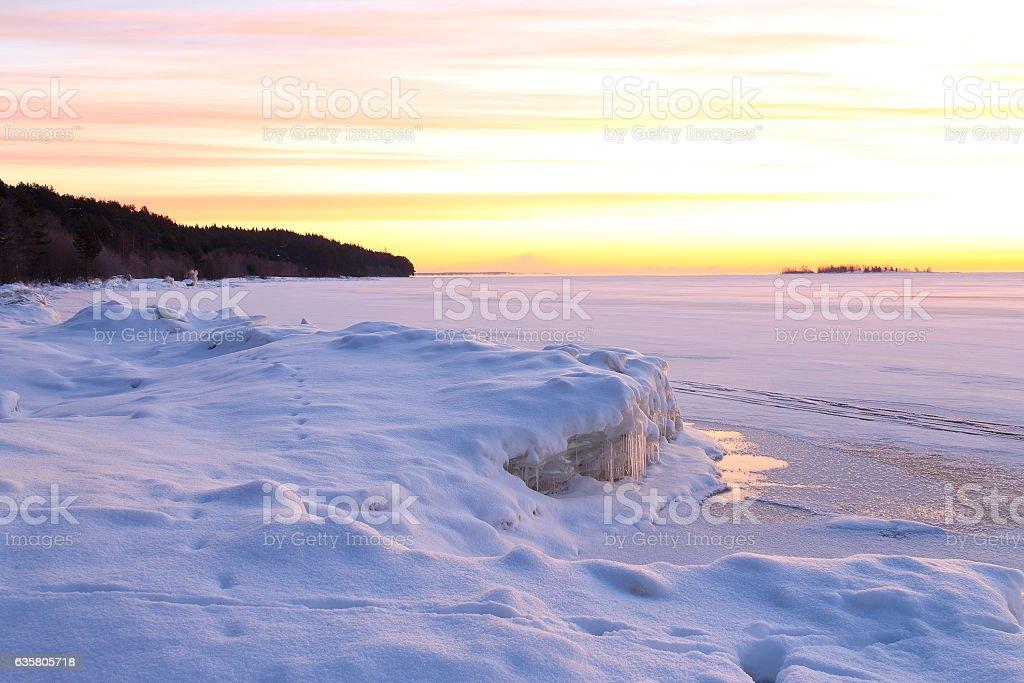 Idyllic snow landscape with beautiful winter sunrise stock photo