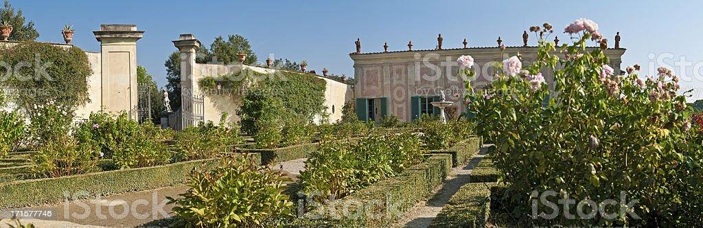 Idyllic summer gardens pink roses traditional Tuscan villa Florence Italy stock photo