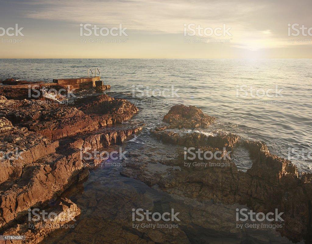 Idyllic sunset at the rocky beach royalty-free stock photo