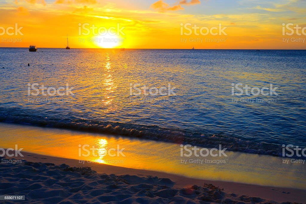 Idyllic sunset in Palm Beach, Aruba, Caribbean Sea stock photo