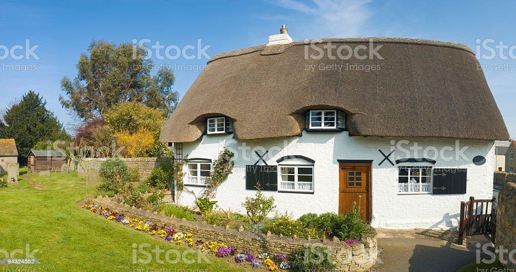 Idyllic thatched cottage stock photo