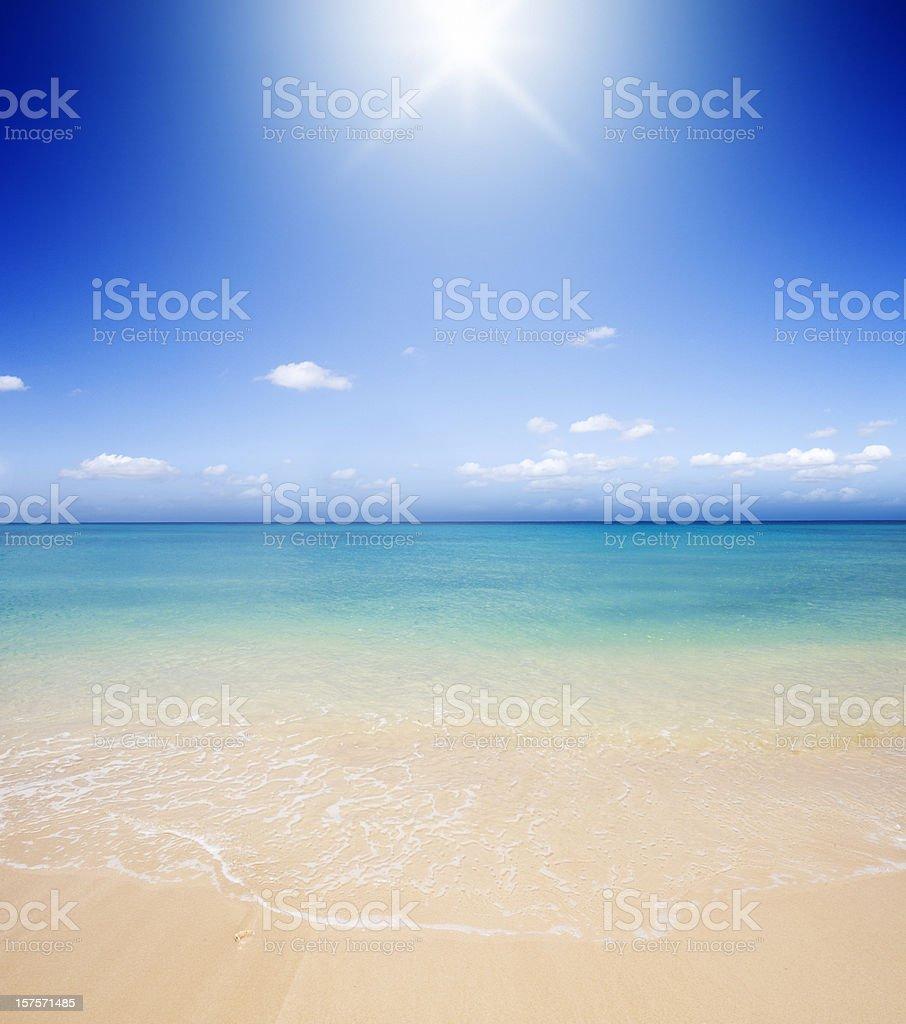 Idyllic Tropical Beach Backlit with Sunlight royalty-free stock photo