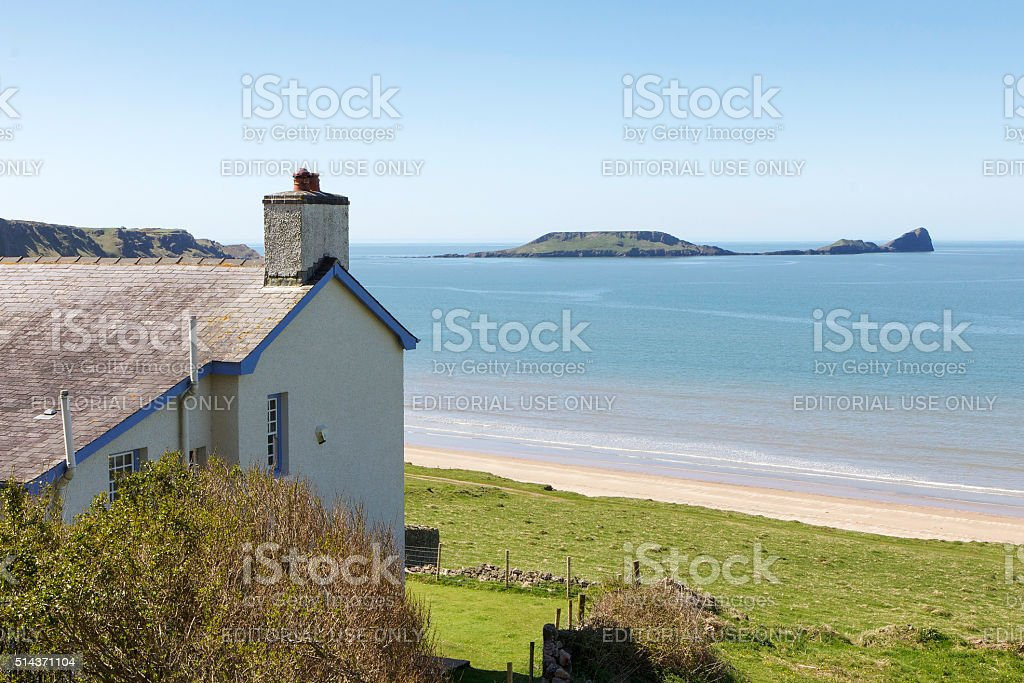 Idyllic White Cottage on the Beach stock photo