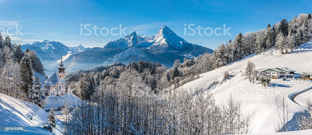Idyllic winter landscape in the Alps with pilgrimage church stock photo