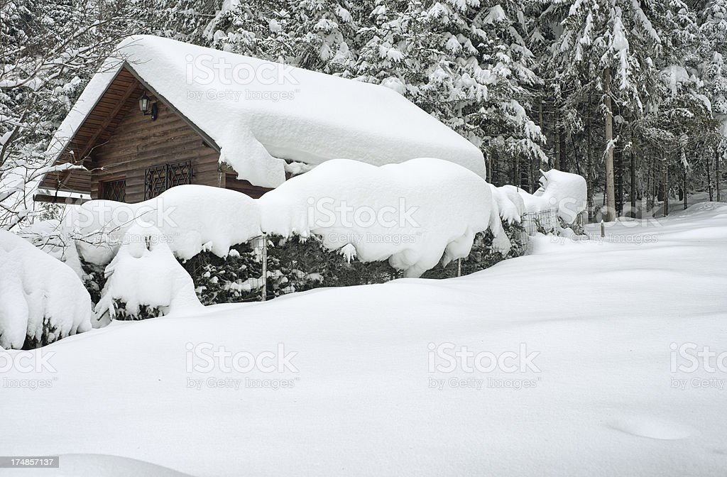 Idyllic wooden house in winter royalty-free stock photo