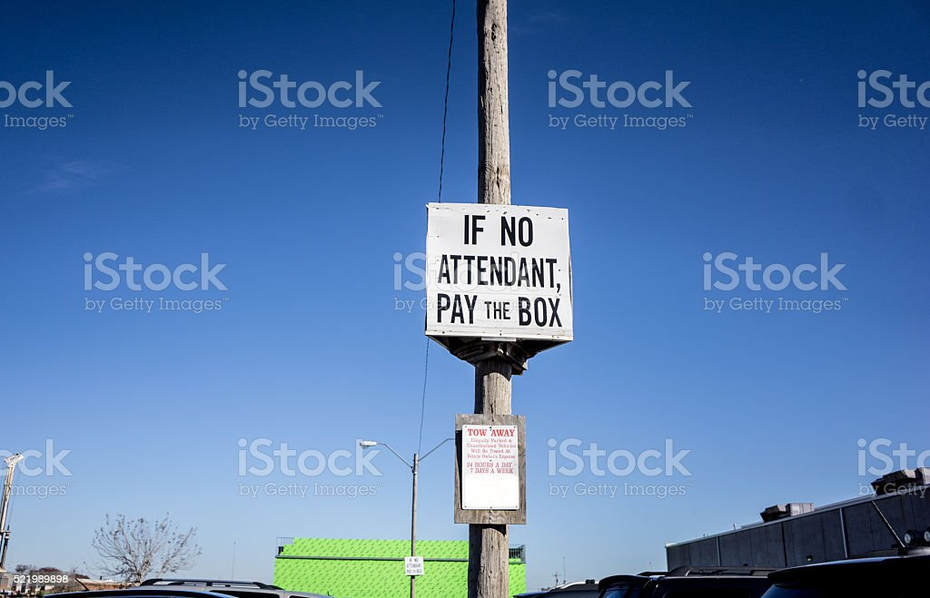 If not Attendant Pay the Box Sign stock photo