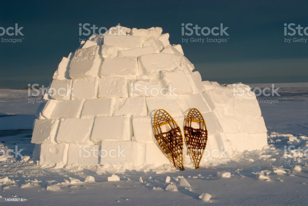 Igloo and Snowshoes stock photo