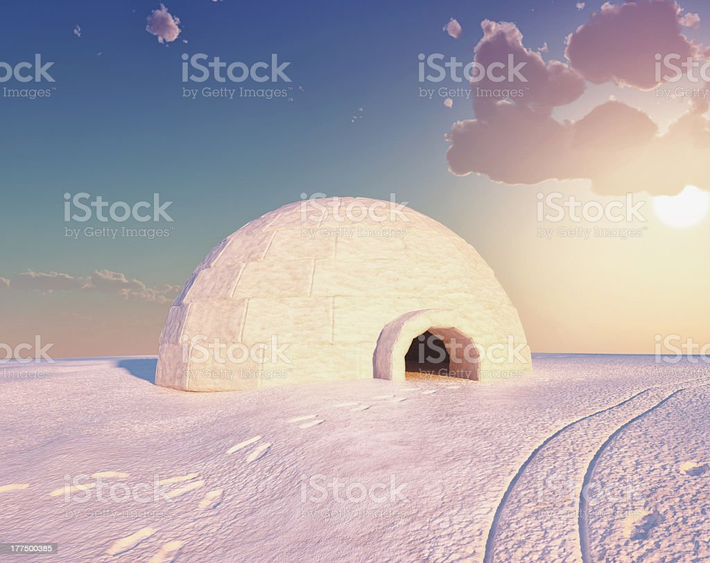 Igloo in the sunshine with footprints in the snow stock photo
