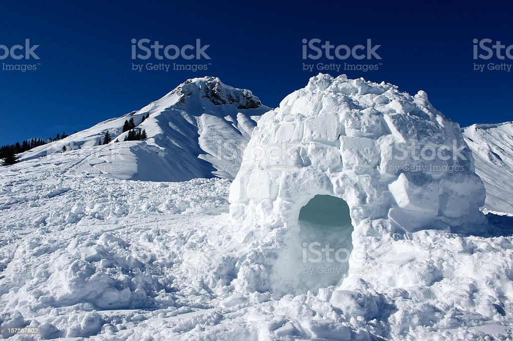 Igloo made of snow near mountain stock photo