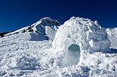 Igloo made of snow near mountain