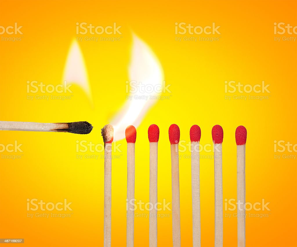 Igniting a process concept - matches row with flame stock photo