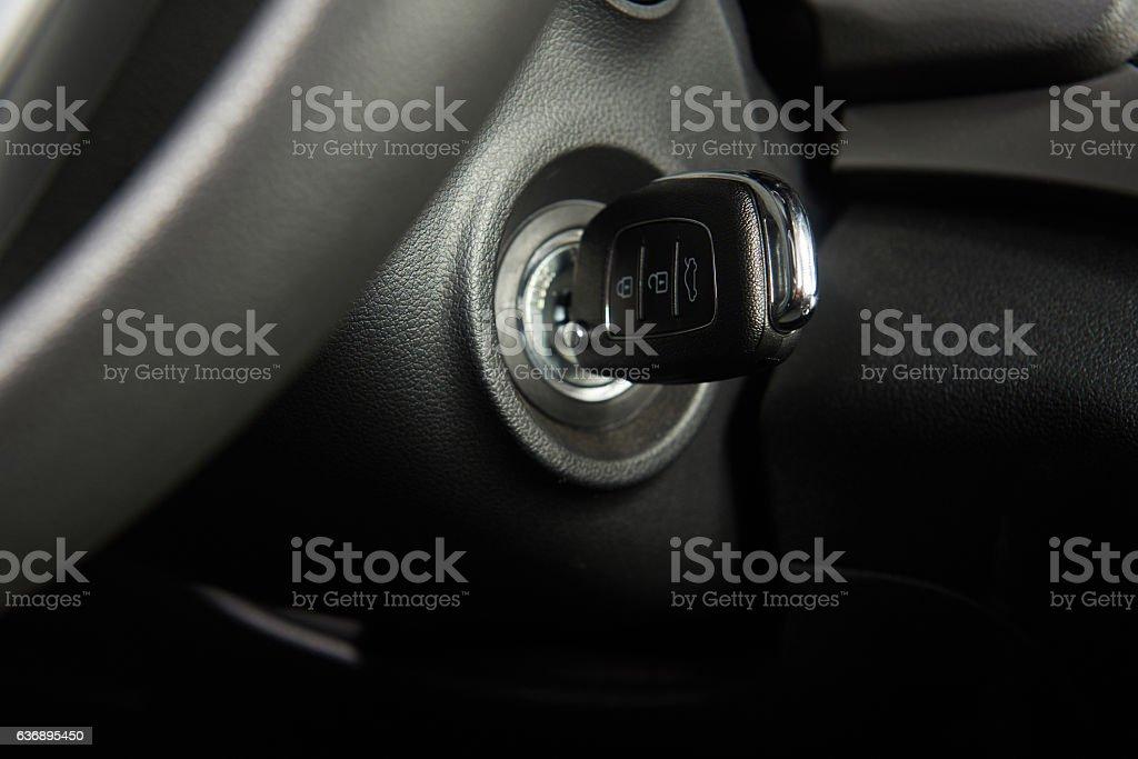 Ignition key of modern car stock photo
