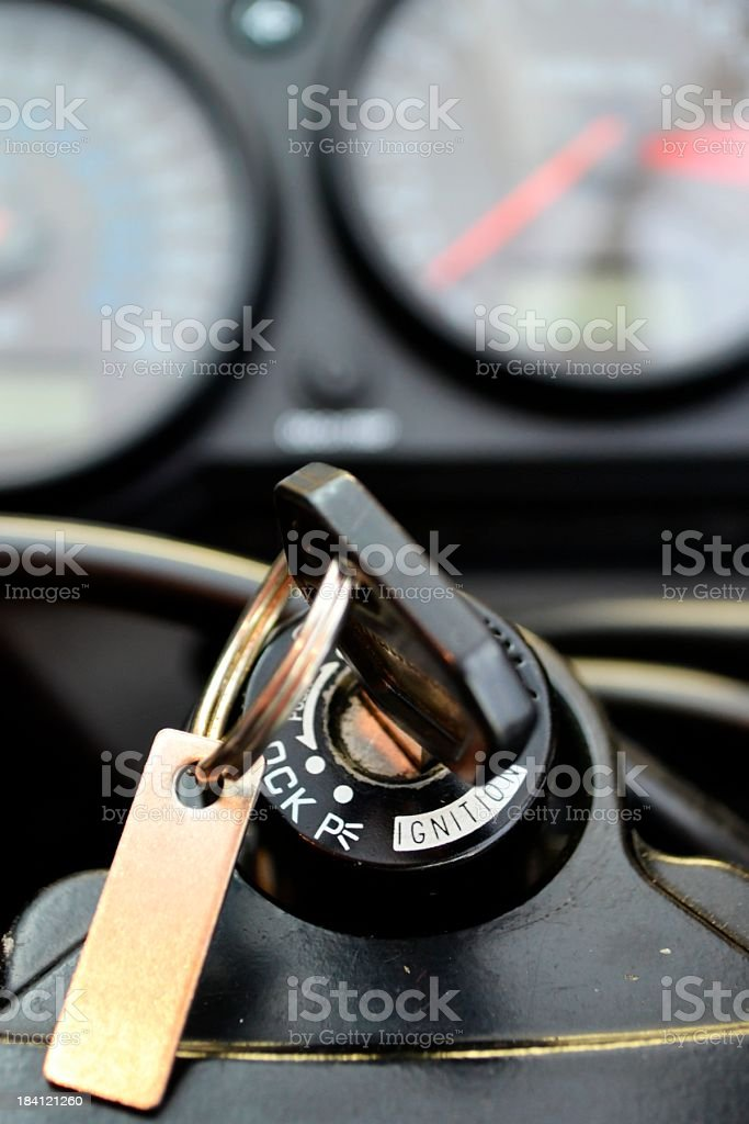 Ignition Key to Motorcycle with Speedometor Full Frame Background stock photo