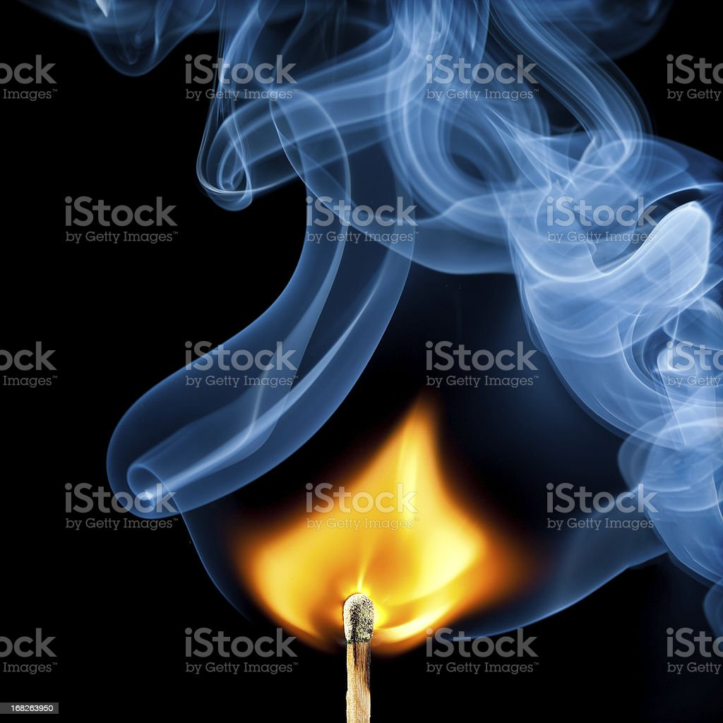 Ignition of match, with smoke on black royalty-free stock photo