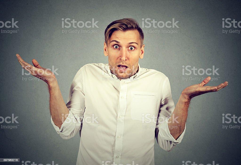 Ignorance arrogance. man shrugging shoulders I don't know stock photo