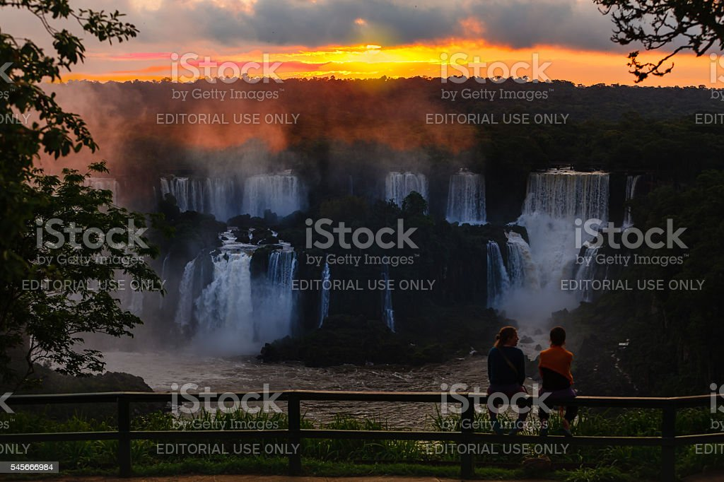 Iguacu, Brazil - tourists watch sunset over the falls stock photo