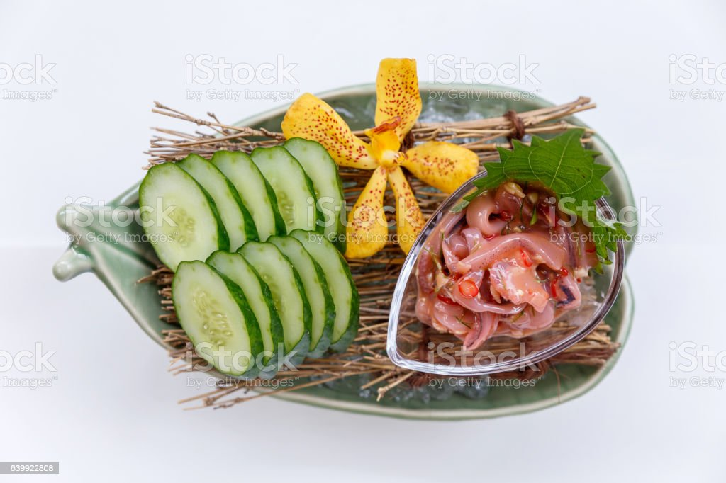 Ika No Shiokara Served with Sliced Cucumber. stock photo