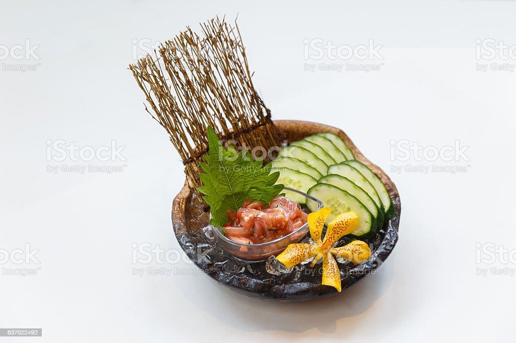 Ika Shiokara with Chillies Served with Sliced Cucumbers. stock photo