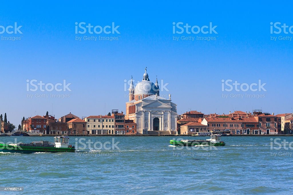Il Redentore Church, Giudecca Canal and Island, 2 Barges; Venice stock photo