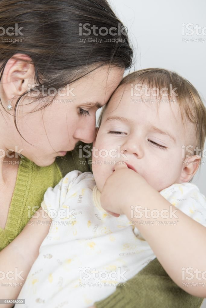 Ill baby with high temperature stock photo