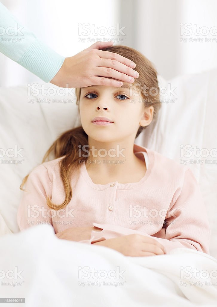 ill girl child and caring mother stock photo