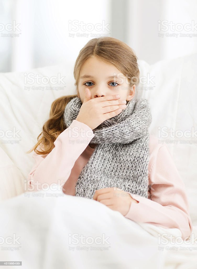 ill girl in scarf with flu coughing in bed at home stock photo
