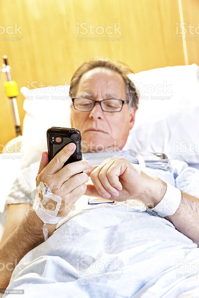 Ill hospital patient talks on the phone royalty-free stock photo