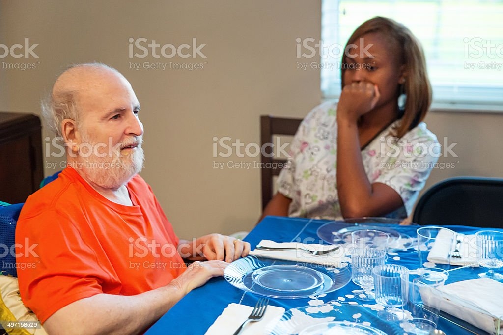 Ill man and his caregiver at a Passover sedar. royalty-free stock photo