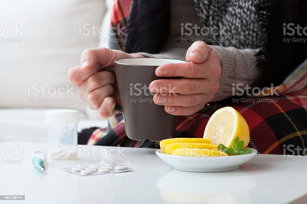 Ill man and hot drink stock photo